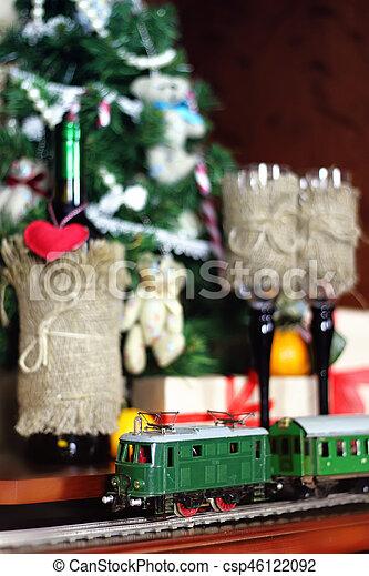 train under tree gift - csp46122092