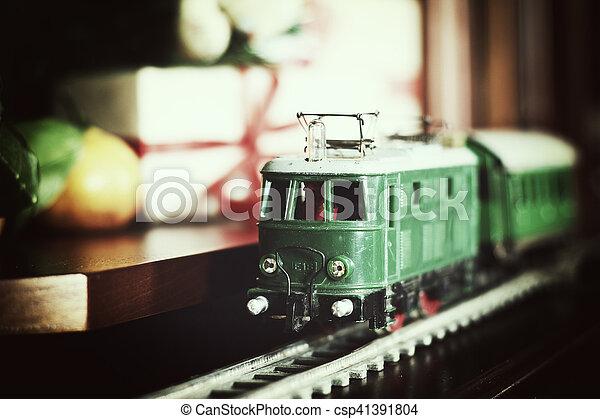 train under tree gift - csp41391804