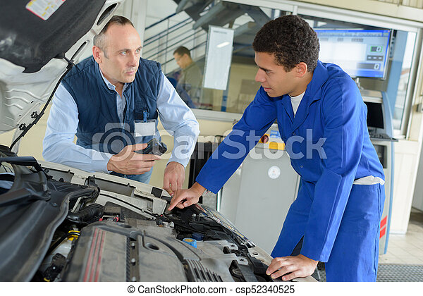 trainee mechanic at work - csp52340525