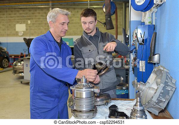 trainee mechanic at work - csp52294531