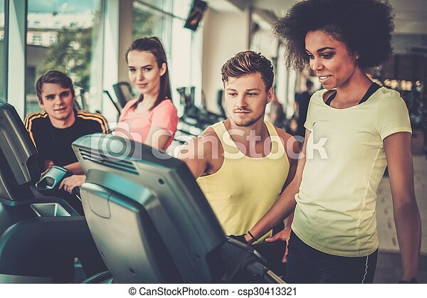 Trainer explaining how to use treadmill - csp30413321