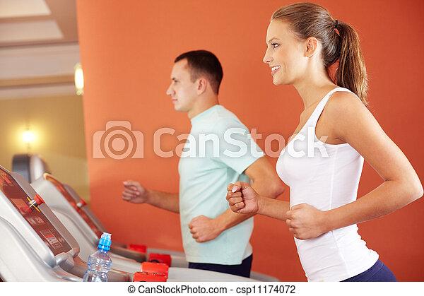 Training in gym - csp11174072