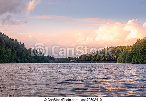 Tranquil mountain lake at sunset with reflections - csp79592410