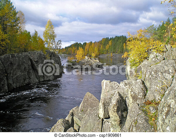 Tranquil river flow before waterfall in the forest - csp1909861