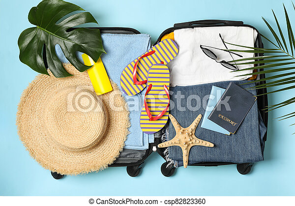 Travel accessories on blue background, top view - csp82823360