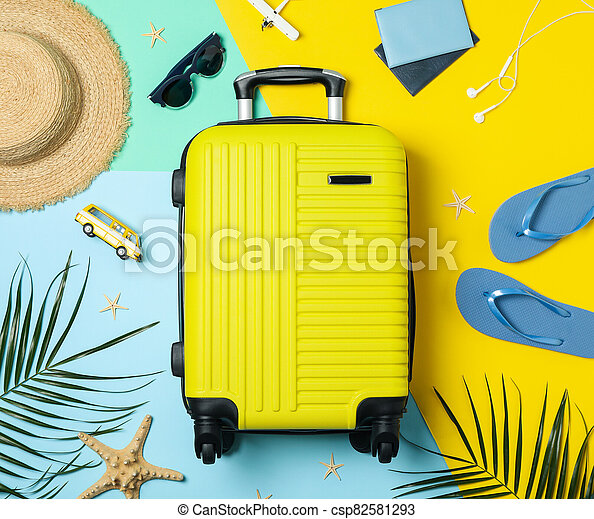 Travel accessories on two tone background, top view. Travel blogger - csp82581293