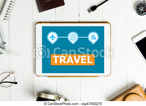 Travel Application screen on white tablet with travel accessories - csp47453270