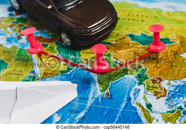 Travel destination points on world map indicated with stock photo travel destination points on world map indicated with colorful thumbtacks rope and shallow depth of gumiabroncs Choice Image