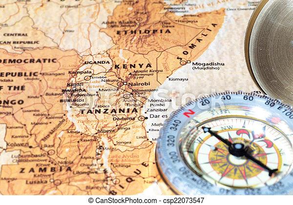 Travel destination Tanzania and Kenya, ancient map with vintage compass - csp22073547
