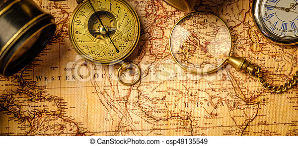 Old vintage retro compass and spyglass on ancient world map vintage old vintage retro compass and spyglass on ancient world map vintage still life travel geography navigation concept background top view gumiabroncs Gallery
