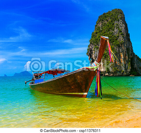 Travel landscape, beach with blue water and sky at summer  Thailand nature beautiful island and traditional wooden boat  Scenery tropical paradise resort - csp11376311