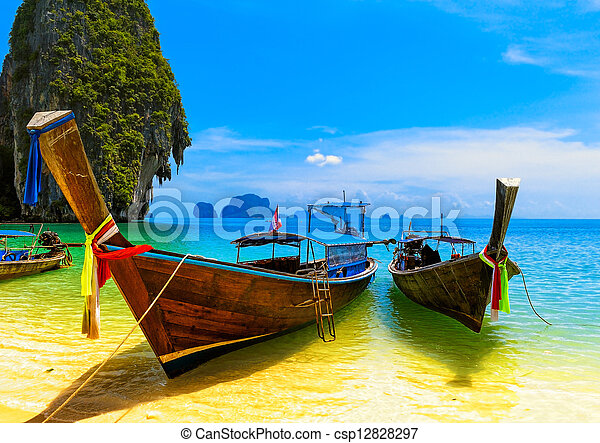 Travel landscape, beach with blue water and sky at summer. Thailand nature beautiful island and traditional wooden boat. Scenery tropical paradise resort - csp12828297