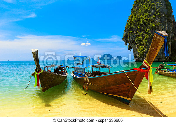 Travel landscape, beach with blue water and sky at summer. Thailand nature beautiful island and traditional wooden boat. Scenery tropical paradise resort. - csp11336606