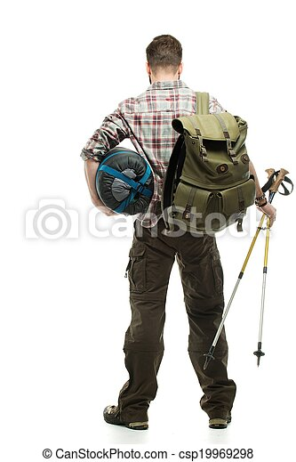 Traveler with backpack, hiking poles and sleeping bag  - csp19969298