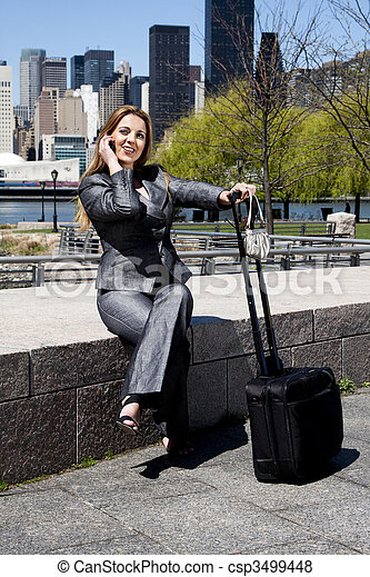 Traveling business woman on phone - csp3499448
