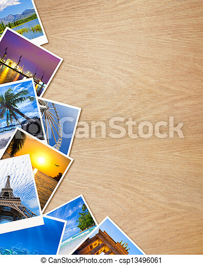 Traveling photos on wooden background - csp13496061