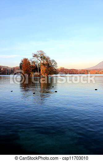 tree in annecy Lake - csp11703010