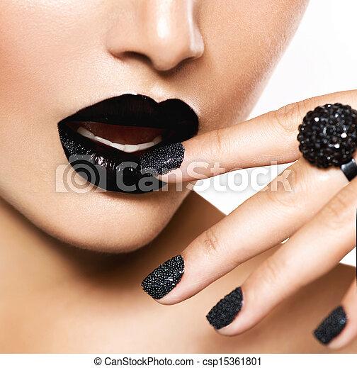 Trendy Black Caviar Manicure and Black Lips. Fashion Makeup - csp15361801