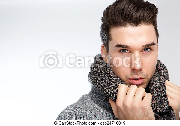 Trendy young man posing with gray wool scarf - csp24710019