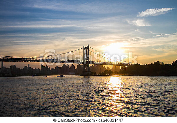 Triborough bridge over the river and sunset, New York - csp46321447