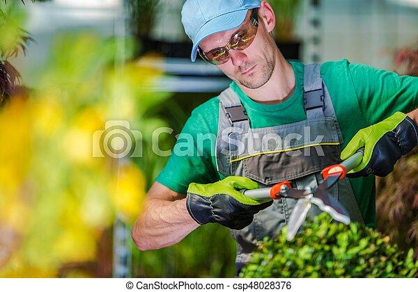 Trimming Garden Plants - csp48028376