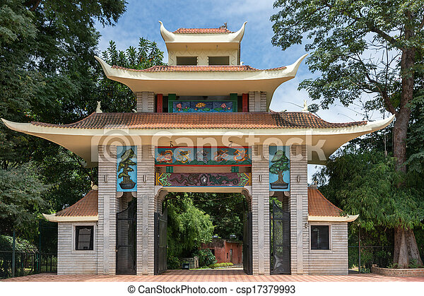 Triple roofed gate with colorful decorations mark the entrance to the Japanese Garden in Bangalore. - csp17379993