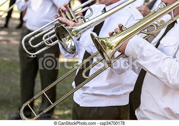 trombone players of military brass band - csp34700178