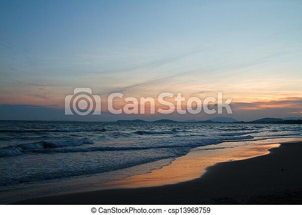 Tropical beach at beautiful sunset. Nature background   - csp13968759