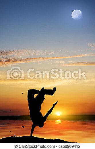 Tropical beach at beautiful sunset. - csp8969412