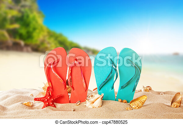 726a7529f Tropical beach with colored flip flops