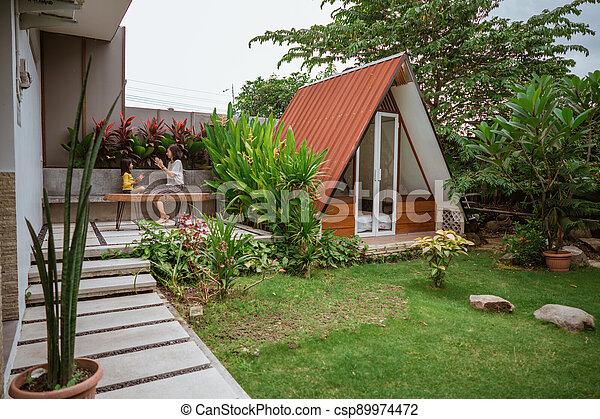 Tropical Garden backyard - csp89974472