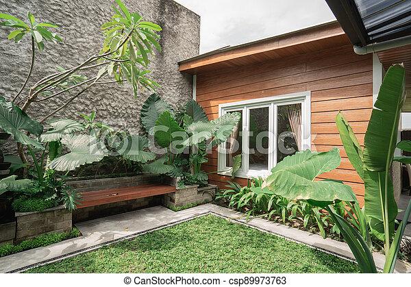 Tropical Garden backyard - csp89973763
