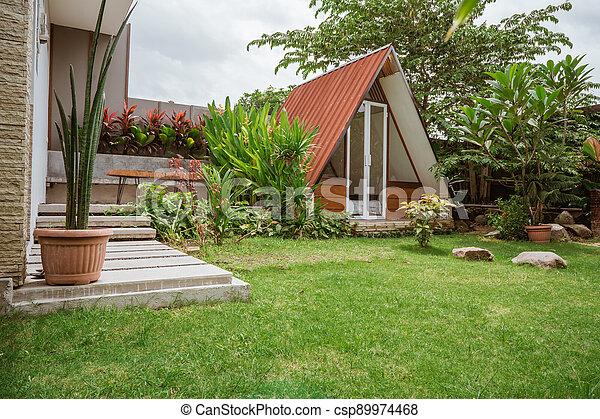 Tropical Garden backyard - csp89974468