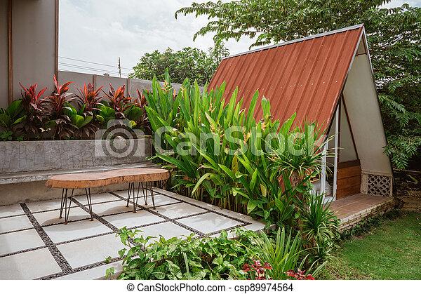 Tropical Garden backyard - csp89974564