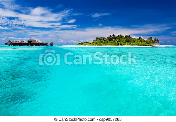 Tropical Island and over water bungalows - csp9057265
