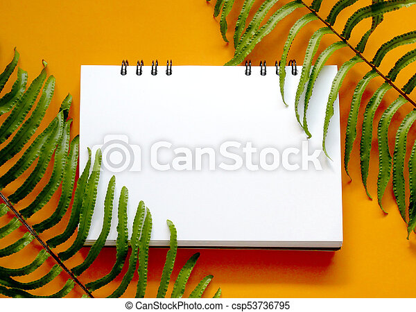 Creative Nature Layout Made Of Tropical Leaves With Blank Notebook On Orange Background Flat Lay Nature Concept Canstock Photo about creative tropical fresh palm leaves set. https www canstockphoto com tropical leaves with blank notebook 53736795 html