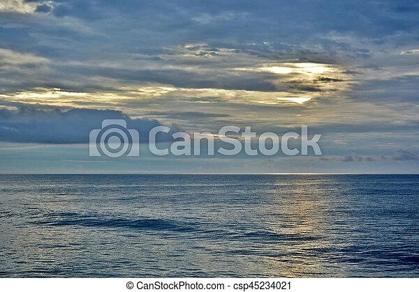 Tropical Paradise Sunrise Over the Sea - csp45234021