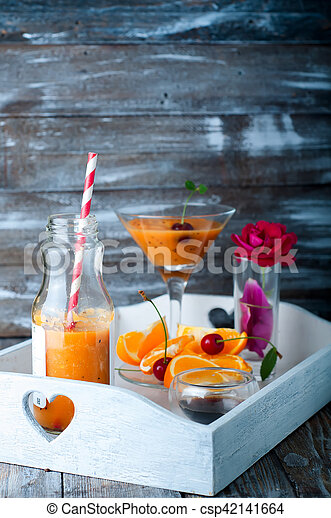 tropical smoothie in glass bottles - csp42141664