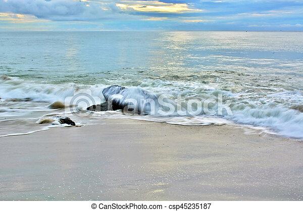 Tropical Sunrise Over Beach Jetty - csp45235187
