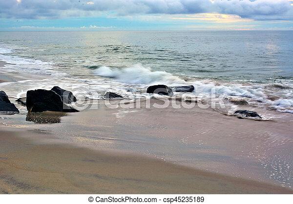 Tropical Sunrise Over Beach Jetty - csp45235189