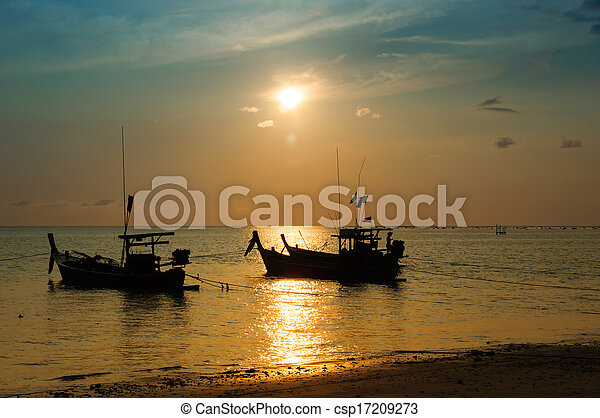 Tropical sunset and boat on the beach - csp17209273