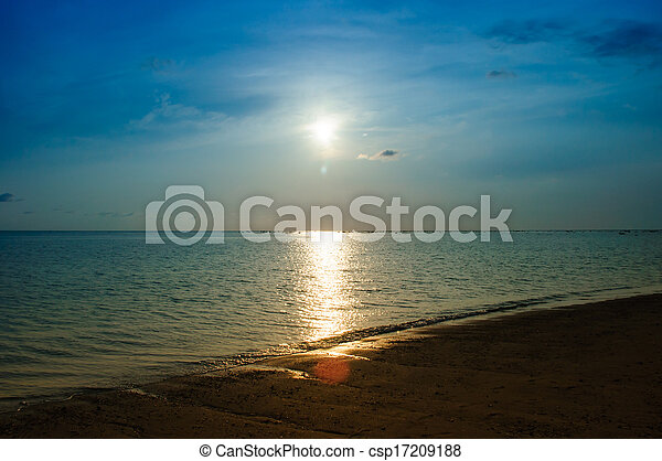 Tropical sunset and boat on the beach - csp17209188