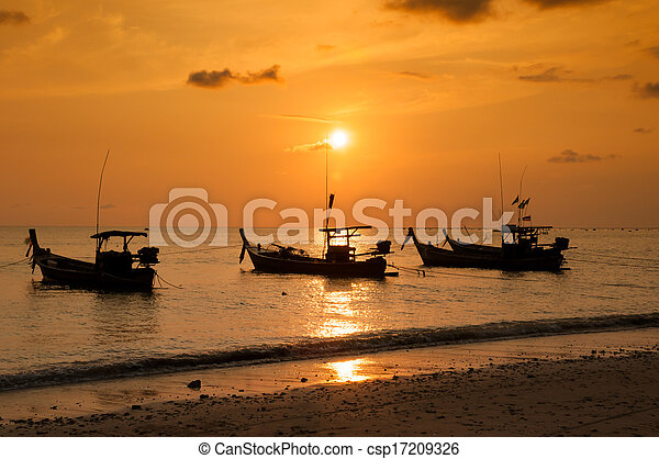 Tropical sunset and boat on the beach - csp17209326
