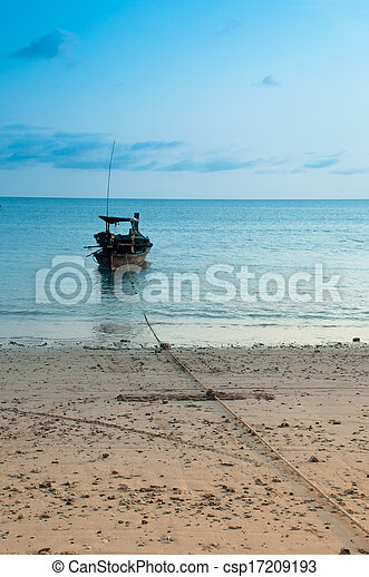 Tropical sunset and boat on the beach - csp17209193
