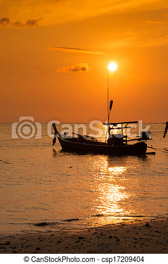 Tropical sunset and boat on the beach - csp17209404
