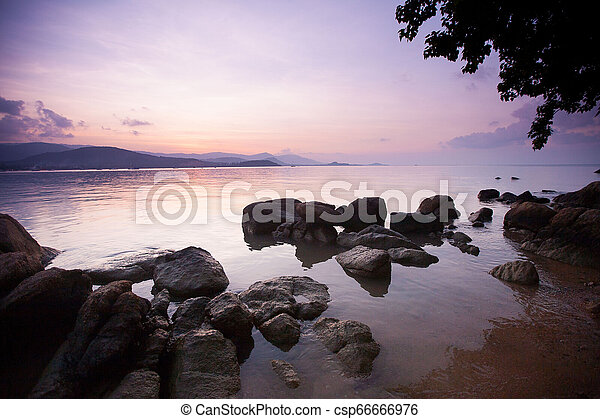 Tropical sunset on the beach - csp66666976