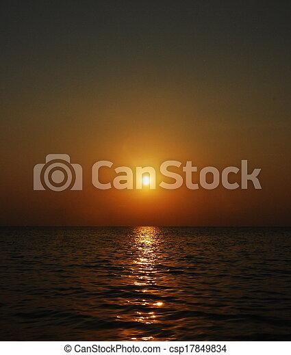 Tropical sunset on the beach - csp17849834
