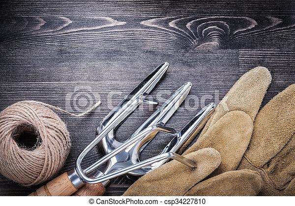 Trowel fork rake protective gloves hank of rope gardening concep - csp34227810