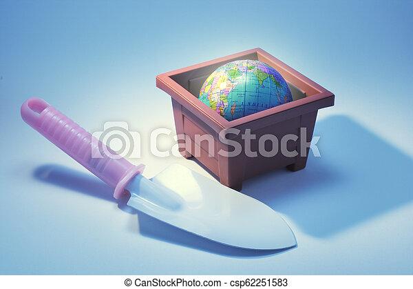 Trowel with Globe in Flower Pot - csp62251583