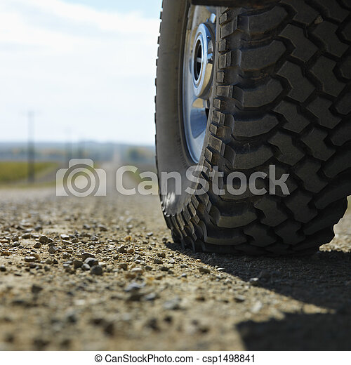 Truck tire on road. - csp1498841